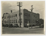 Photograph of the Snyder Ice Cream Company with cars parked in front, undated